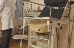 Spy cam setup in gyno clinic checkup office.